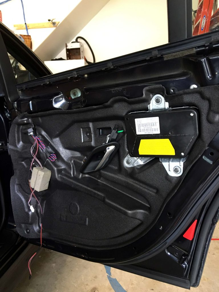 leaking rear door vapor barrier repair – 2003 BMW E39