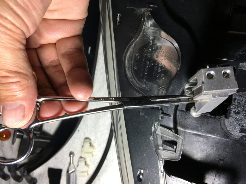 forceps to install adjuster